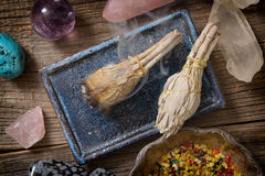 Burning white sage incense. Burning natural white sage incense and multiple gemstones Royalty Free Stock Photos