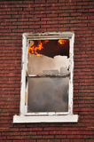 Burning Window. A burning window in an apartment fire Royalty Free Stock Photo