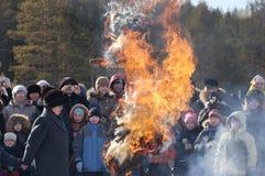 Burning Winter effigy at Shrovetide Stock Photos