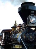 Burning Wood. Narrow gauge wood burning locomotive proceeding down the track stock photography