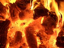 Burning wood. Some woods burning on a fireplace royalty free stock photos