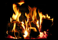 Burning wood. Wood burning inside a fireplace royalty free stock photos