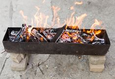 Burning wood in a brazier. In the park in nature Royalty Free Stock Images