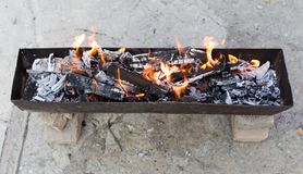 Burning wood in a brazier. In the park in nature Stock Photography
