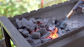 Burning wood in a brazier. Fire, flames. Grill or barbecue stock video footage