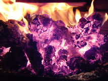 Burning wood and embers Stock Images