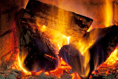Burning wood in fireplace Stock Photography