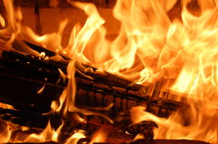 Burning wood in the fireplace. Stock Image