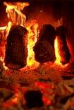 Burning wood on fireplace Stock Photos