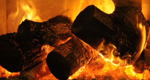 Burning wood in fireplace Stock Images