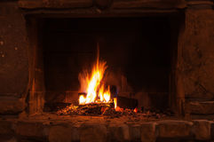Burning wood in a fireplace Royalty Free Stock Image