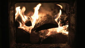 Burning wood in a fireplace stock video