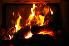 Burning wood in the fireplace Royalty Free Stock Image