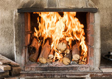 Burning wood in the fireplace Stock Photography