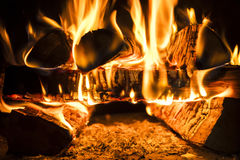Burning wood, the heat Royalty Free Stock Photo