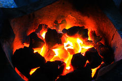 Burning wood in hot stove Stock Image