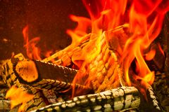 Burning wood logs, cooking on fire, warm evening, sparkles in th. E air, warm air from the fire stock photography