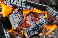Burning wood logs, cooking on fire, warm evening, sparkles in th. E air, warm air from the fire royalty free stock images