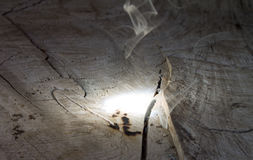 Burning wood with magnifying glass. Royalty Free Stock Photos