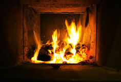 Burning wood in the oven Stock Image