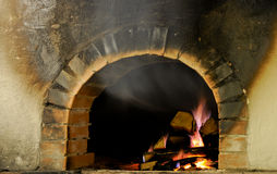 Burning wood in an oven just turned Royalty Free Stock Photography