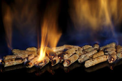 Burning wood pellets Stock Photo