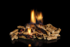 Burning wood pellets Royalty Free Stock Photo