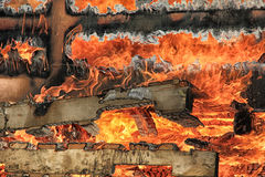 Burning wood. Red hot fire destroying scrap wood Stock Images