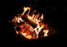 Burning wood - red and orange fire for warming hands Stock Photography