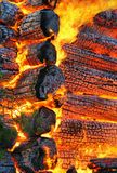 Burning wooden house. Close-up royalty free stock photo
