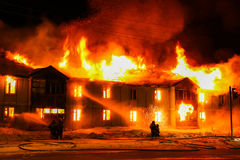 Burning wooden house Royalty Free Stock Images