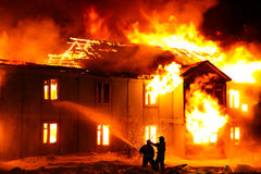 Burning wooden house Royalty Free Stock Photos