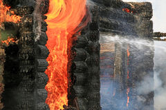 Burning wooden house Stock Images