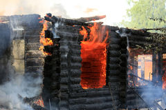 Burning wooden house Royalty Free Stock Photos
