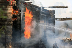 Burning wooden house. In the village burning of a large wooden house stock image