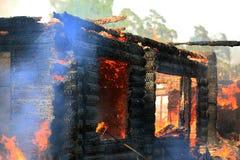 Burning wooden house Royalty Free Stock Photo