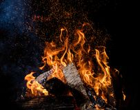 Burning wooden logs in fire, campfire on black. Burning wooden logs in fire, campfire isolated on black background stock photography