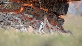 Burning wooden military crates from ammunition. The smoldering fireplace. Big fire. stock footage