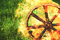 Burning wooden wheel rolling Royalty Free Stock Photos