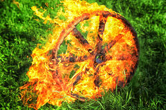 Burning wooden wheel rolling Royalty Free Stock Image