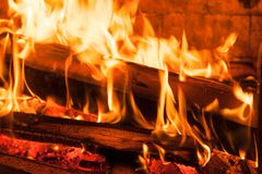 Burning woods ember in fireplace Stock Photos
