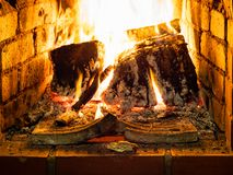 Burning woods in hearth. In rural house close up stock images