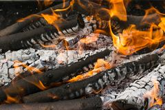 Burning woods at night. Flame and fire sparks closeup stock images