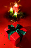 Burning xmas candle and little gift box Royalty Free Stock Image