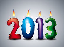 Burning Year 2013 Candles. The year 2013 made from colorful candles lit and dripping wax Royalty Free Stock Images