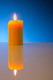 Burning yellow candle Stock Photos