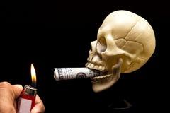 Burning your Money. A lighter burning a dollar cigar royalty free stock photos
