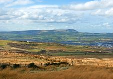 Burnley Town. Moorland scene in Lancashire, north-east England, with Burnley town and Pendle Hill in the background stock images