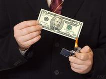 burnning χρήματα χεριών Στοκ Εικόνες