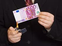 burnning деньги рук Стоковые Фотографии RF